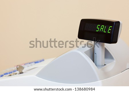A cash register with the word SALE on the electronic display, copy space to add your own text. - stock photo