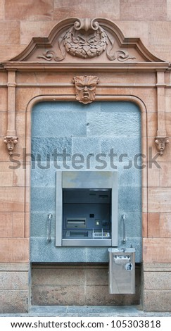 A cashpoint machine situated in an urban location. - stock photo