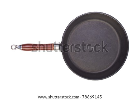A cast-iron frying pan on a white background. - stock photo
