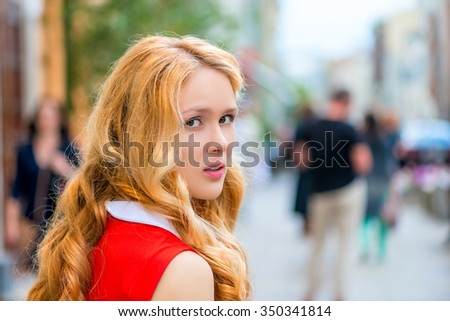 a casual portrait of a beautiful girl turning back