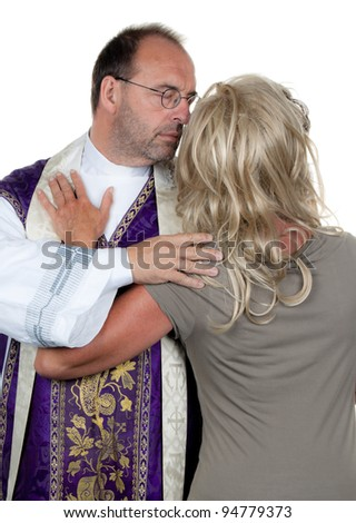 a catholic priest in love with his girlfriend. photo icon celibacy - stock photo