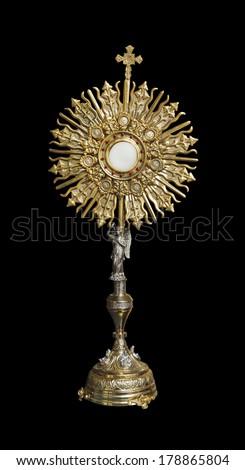 A Catholic priest santisimo host at Communion - stock photo