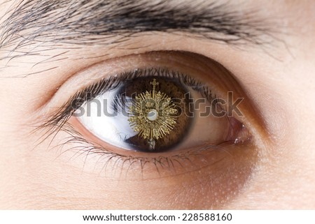 A Catholic priest santisimo host at Communion. Eye looking  Jesus Eucharist - stock photo