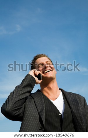 A caucasian businessman talking on the phone outdoor