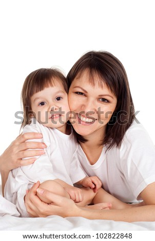 A Caucasian mum with her daughter on the bed