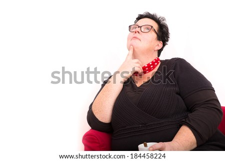 A caucasian overweight woman in the office. - stock photo