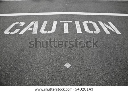 a caution sign in the street indication for cars to watch for pedestrians crossing