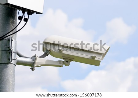 a cctv camera in the town on the wall