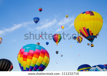 A celebration of hot air balloons on a summer day