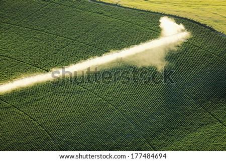 A center pivot sprinkler used to irrigate a potato field. - stock photo
