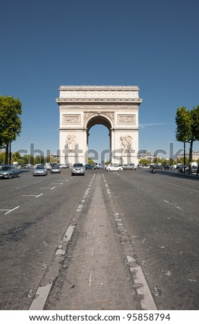 A centered head-on view of the iconic Arc De Triomphe on Champs Elysees avenue in Paris, France.  Vertical. - stock photo