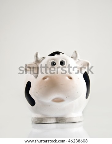 A ceramic cow isolated on white background - stock photo