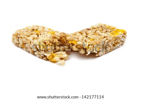 A cereal bar over a white background. - stock photo