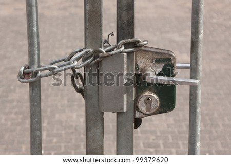 A chain hanging on a abandoned gate (Holland) - stock photo