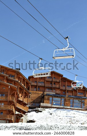 A chairlift on a ski resort during winter on a bright day. - stock photo