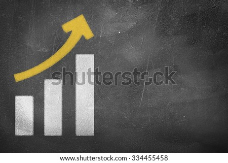A chalkboard with drawings of a growth graph - stock photo
