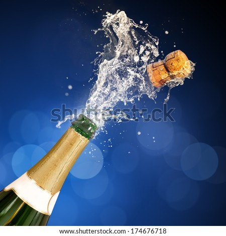 A champagne bottle popping open. Celebrations. - stock photo