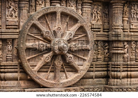 A chariot wheel carved into the wall of the sun temple at Konark, India. - stock photo