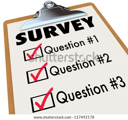 A checklist on a wooden clipboard with the word Survey and a list of questions to gather customer or audience feedback, reviews and reactions to important matters or products - stock photo