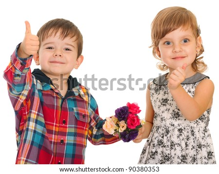 A cheerful girl and a smiling boy are holding their thumbs up; isolated on the white background - stock photo