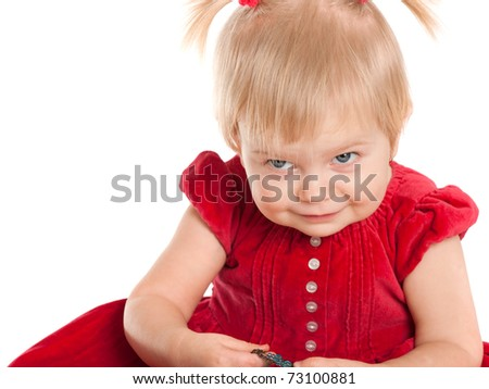 A cheerful girl dressed in a nice red dress is hiding an earring; isolated on the white background - stock photo