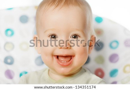 A cheerful happy baby smiling - stock photo