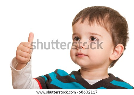 A cheerful kid is holding his thumb up; isolated on the white background (Shallow DOF - Focus on the left eye) - stock photo