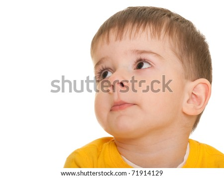 A cheerful little boy looking aside; isolated on the white background