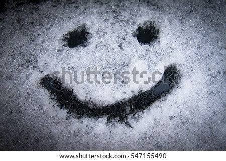 A cheerful snow smiley symbol pattern in the winter on White snow background