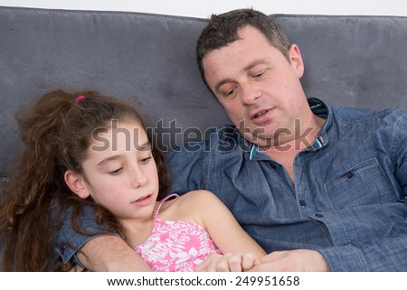 A cheerful young girl with her father - stock photo