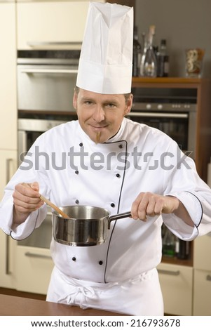 A chef cooking in a kitchen.