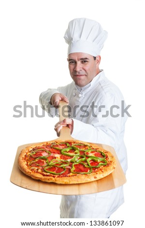 A chef holding a freshly cooked pizza on a white background.