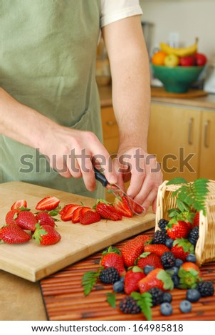 A chef is preparing a delicious fruit salad