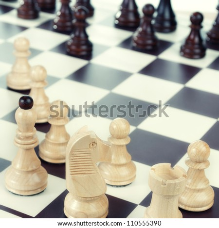 A chess board set up ready for a game,close up photo - stock photo