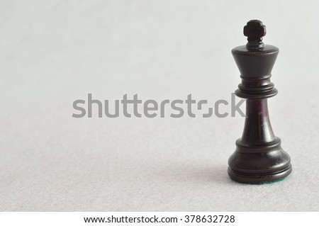 A chess piece isolated on a white background. A black king. - stock photo