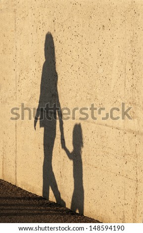 A Child being lead away by a women - stock photo