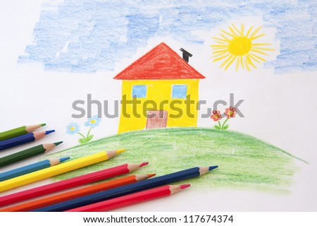 A child draw with an house  and flowers with colorful pencils - stock photo
