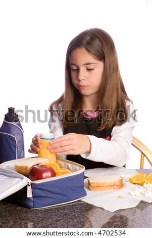 a child eating a healthy lunchbox lunch - stock photo