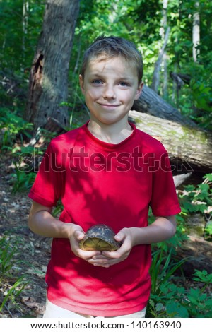 A child found in the woods Three-toed Box Turtle (terrapene carolina triunguis) - stock photo