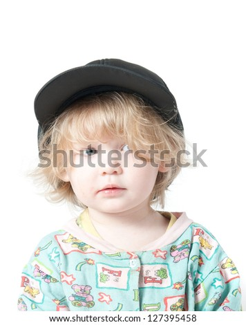 A child in a cap. A child in a cap. Clipping path. - stock photo