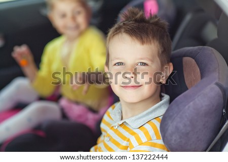 A child in the car seat - stock photo