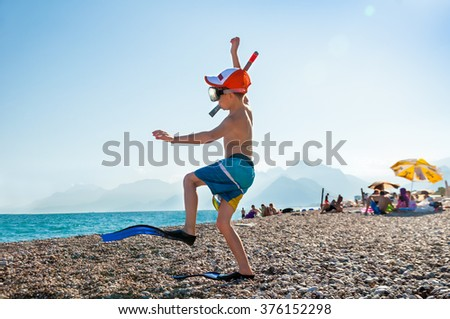 A child in the flippers and snorkel