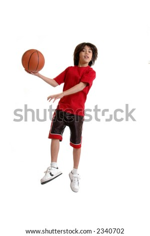 A child jumping to make a basket