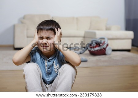 A child keeping his head and crying - stock photo