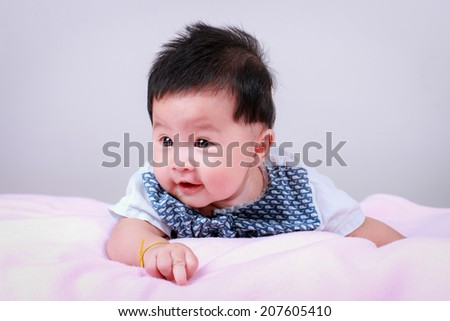 A child lying on a bed