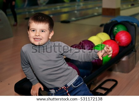 a child makes merry in bowling