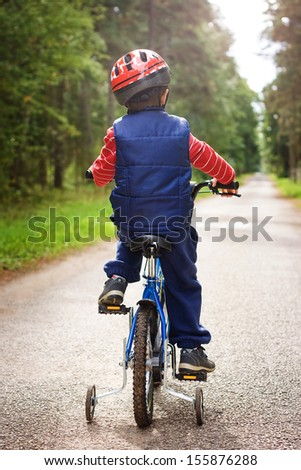 a child on a bicycle - stock photo