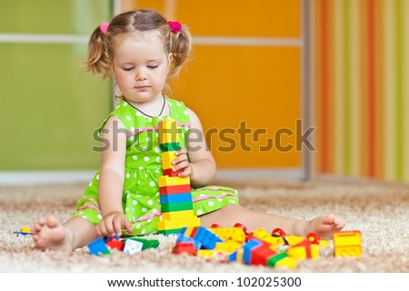 A child playing with blocks