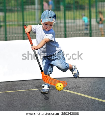 A child plays floorball.Stick and ball games in floorball