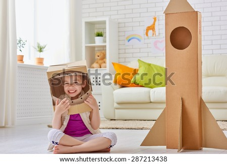 a child plays in the astronaut - stock photo